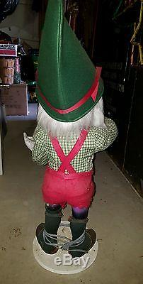 4 life size animated elves Painter Rocking Chair woodworker
