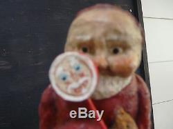 Debbee Thibault Santa holding teddy bear