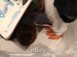 Harold Gale Eskimo reading to penguins