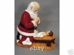 Kneeling Santa and Christ Child in Manger