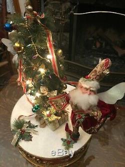Mark Roberts'90s vintage rotating fairies decorating Christmas tree