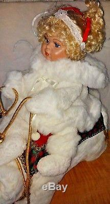 Santa's Best Christmas Animated Collectible snow baby girl doll riding the bear
