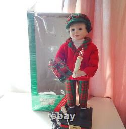 Telco Child Animated Xmas Motionette Doll Boy with Gifts & Candle Holiday Figure