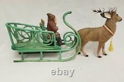 Vintage 1920's Belsnickle sitting with Sleigh and Deer Candy container